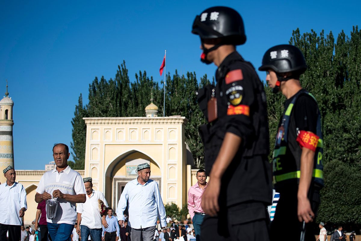 Police patrol outside a mosque in Kashgar (2017)